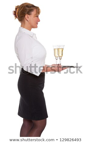 waitress carrying a tray with champagne glasses stock photo © andreypopov