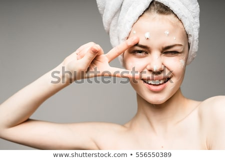 body of beautiful woman covering her breast with hand stock photo © nobilior