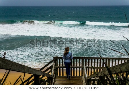 Stock photo: Young woman at windy day on platform