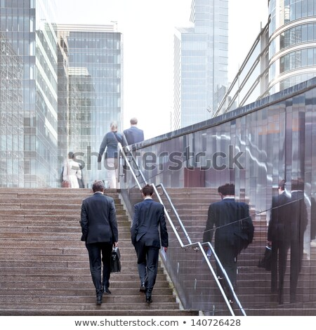 businesswoman on a city street with folder stock photo © ssuaphoto