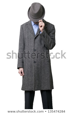 man holding his hat and looking down stock photo © feedough