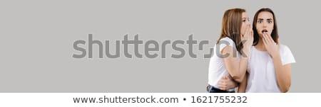 Une brunette fille potins autre isolé Photo stock © Nejron
