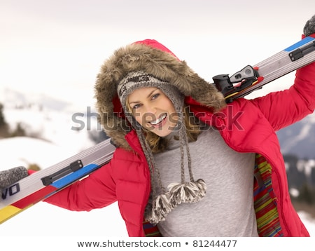 Young Woman holding Skis In Alpine Landscape Stock photo © monkey_business