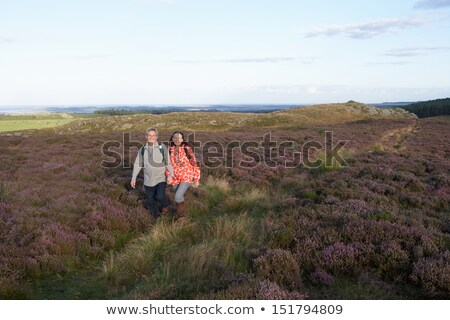 Senior Couple Hiking Across Moorland Covered With Heather Stock photo © monkey_business