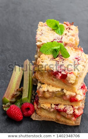 Slice of freshly baked rhubarb crumble stock photo © raphotos