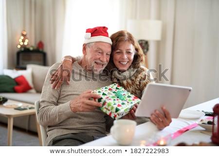 vrouwelijke · christmas · geschenk · kerstman - stockfoto © jenbray