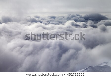 view on off piste slope in storm clouds stock photo © bsani