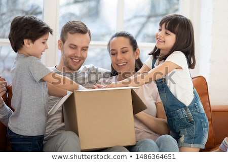 Happy Man Unpacking Online Purchase At Home Stock photo © HighwayStarz