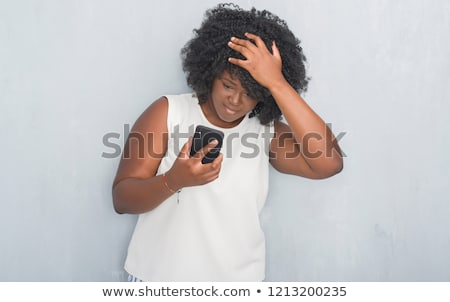 Photo stock: Worried Shocked African Woman