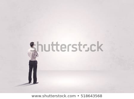 business man holding his hands in pockets stock photo © feedough