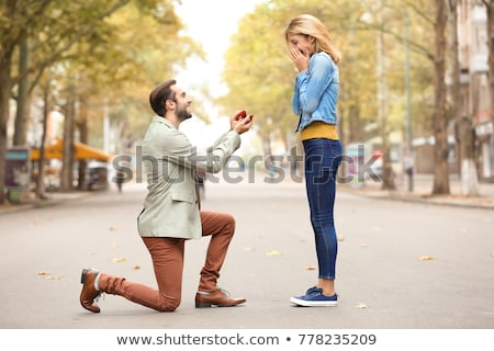 romantic man proposing to beautiful woman Stock photo © dolgachov