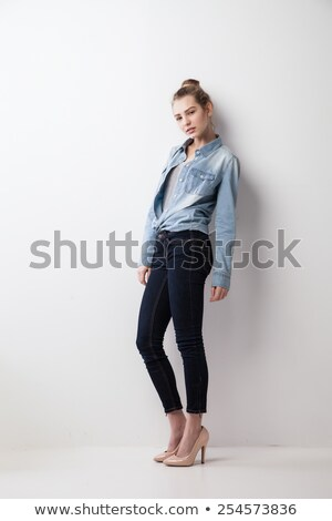 Side view of a young woman leaning on a wall Stock photo © feedough