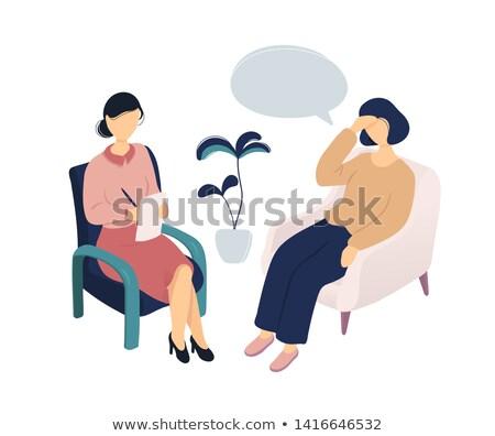 Therapist taking notes on her patient Stock photo © wavebreak_media