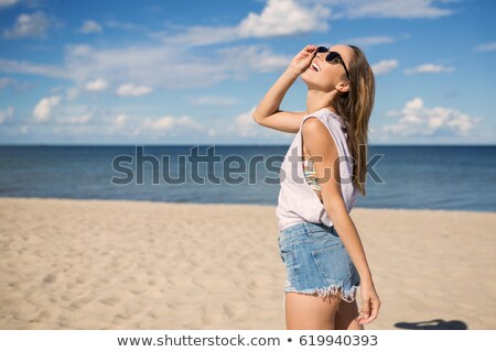 pretty happy young woman relaxing at the seaside stock photo © dash