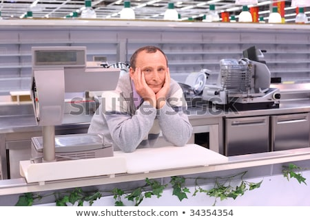 bored seller in shop with empty shelves and counters Stock photo © Paha_L