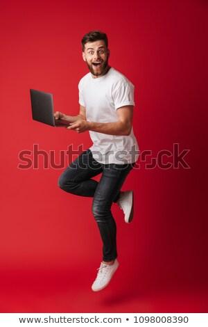 удивление человека ноутбука изолированный белый подчеркнуть Сток-фото © Mikko