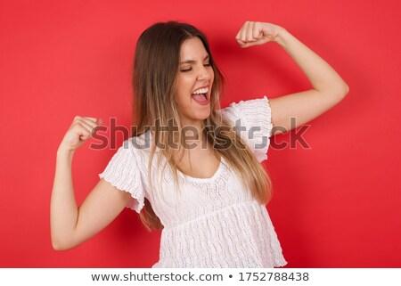 победителем · счастливая · девушка · оружия · жест · победу - Сток-фото © filipw