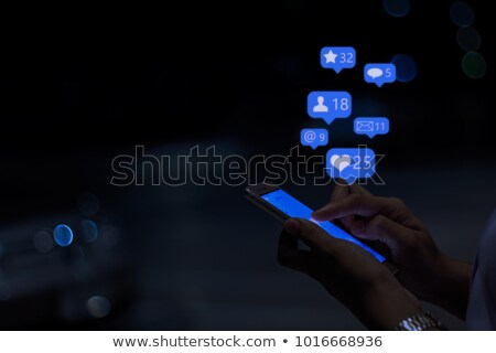 girl typing phone message on social network at night stock photo © diego_cervo