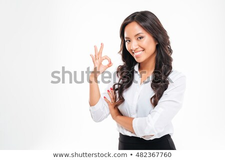happy young asain businesswoman showing ok sign isolated stock photo © deandrobot