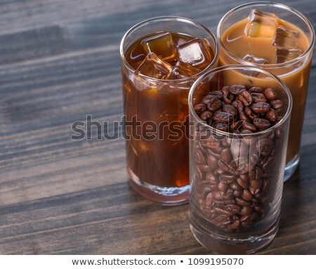 variety iced coffee drinks on wooden table stock photo © nalinratphi