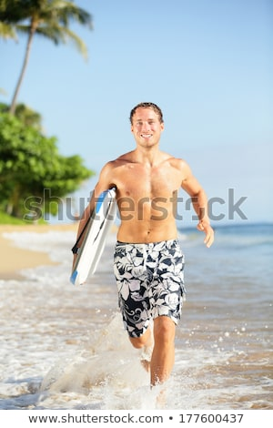 Szörfös férfi szörfözik tengerpart Hawaii USA Stock fotó © Maridav