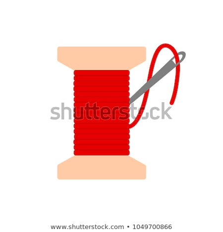 ストックフォト: Spool Of Thread With A Needle On A White Background