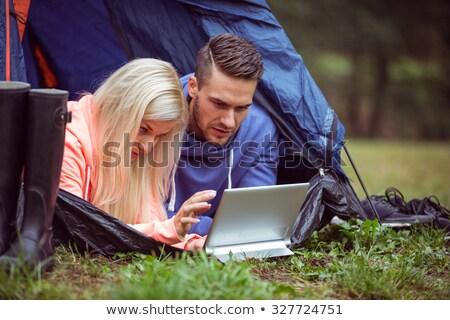 Boldog pár sátor táblagép portré együtt Stock fotó © deandrobot