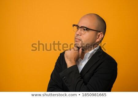 Hombre gafas sonriendo tocar barbilla Foto stock © feedough