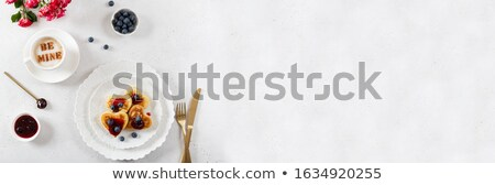Heart shaped red cake on a white plate. Delicious dessert for Valentine's Day Romantic dinner Stock photo © frimufilms