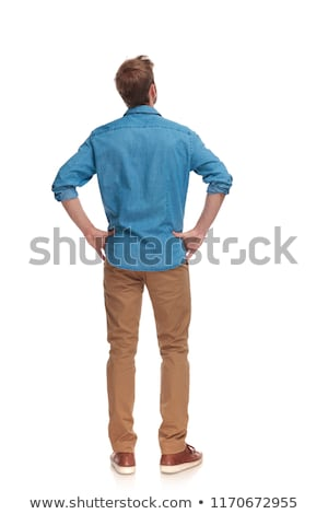 Stock photo: young casual man standing with hands on waist