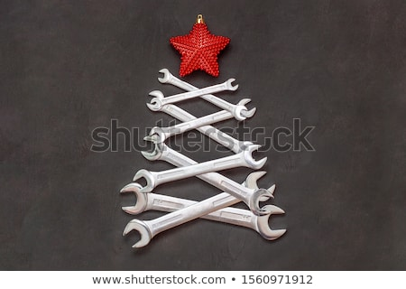 creative christmas tree design made with stars in black backgrou Stock photo © SArts