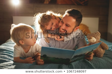 happy child with parents in bed at home Stock photo © tekso