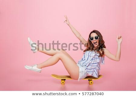 красивая девушка Солнцезащитные очки сидят асфальт девушки город Сток-фото © tekso