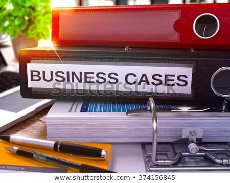 Business Cases on Black Ring Binder. Blurred, Toned Image. Stock photo © tashatuvango