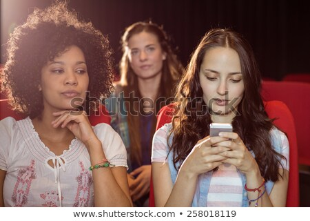Rude Man Texting in a Movie Theater Stock photo © cteconsulting