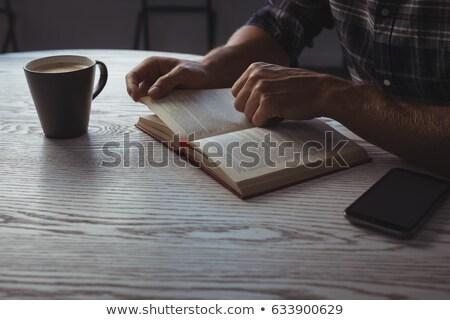 Középső rész üzletember olvas magazin asztal iroda Stock fotó © wavebreak_media