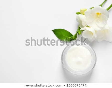 spa cosmetic cream and flower isolated on white stock photo © julenochek