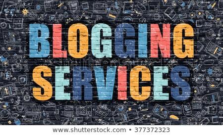 blogging services concept multicolor on dark brickwall stock photo © tashatuvango