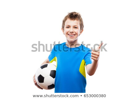 Handsome smiling child boy holding soccer ball gesturing thumb up success sign Stock photo © ia_64