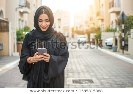 Moslim vrouw smartphone geïsoleerd zwarte Stockfoto © LightFieldStudios
