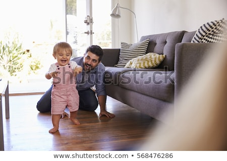 Father watching baby walking Stock photo © IS2