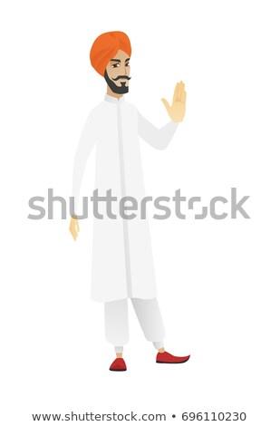 Hindu businessman showing palm hand. Stock photo © RAStudio