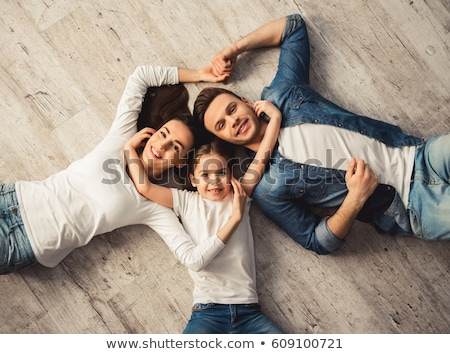 Mom and girl on floor, looking at camera Stock photo © IS2