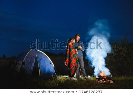 Girls in near tent at dusk Stock photo © IS2