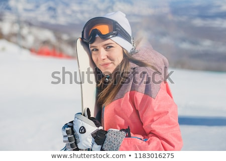 woman with skis facing camera stock photo © IS2