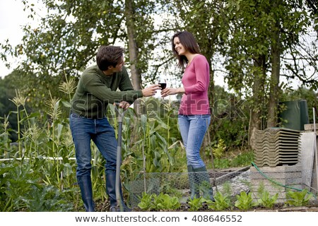 a couple take a break from gardening stock photo © is2