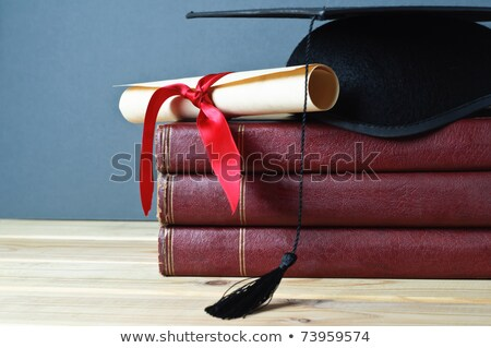 Mortarboard and Parchment Diploma Scroll Tied with Ribbon Stock photo © frannyanne