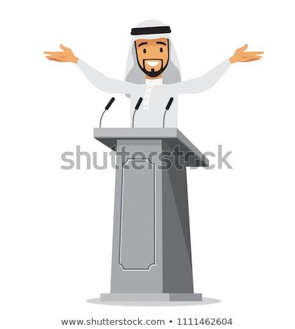 Arabic businessman speech on tribune stock photo © studioworkstock