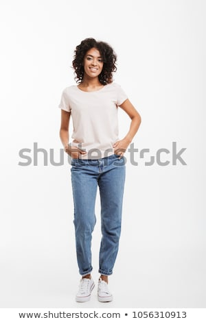 Full length photo of vivacious american woman wearing jeans and  Stock photo © deandrobot