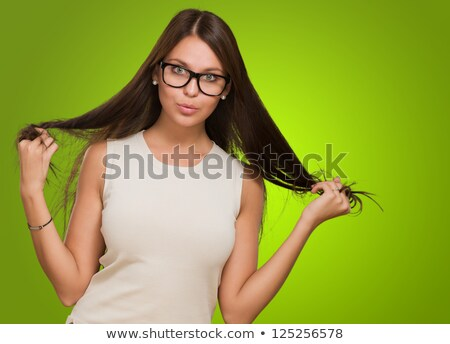 young brunette woman wearing a green long dress standing stock photo © feedough